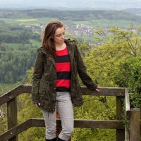 FashionablyEmployed.com   Stripes in pink and gray with an anorak jacket at the top of Mount Uetliberg in Switzerland