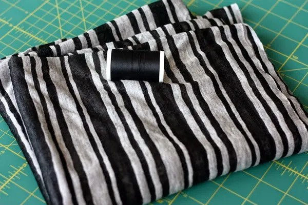 gray and black striped knit fabric with black thread - DIY infinity scarf tutorial - www.honestlymodern.com