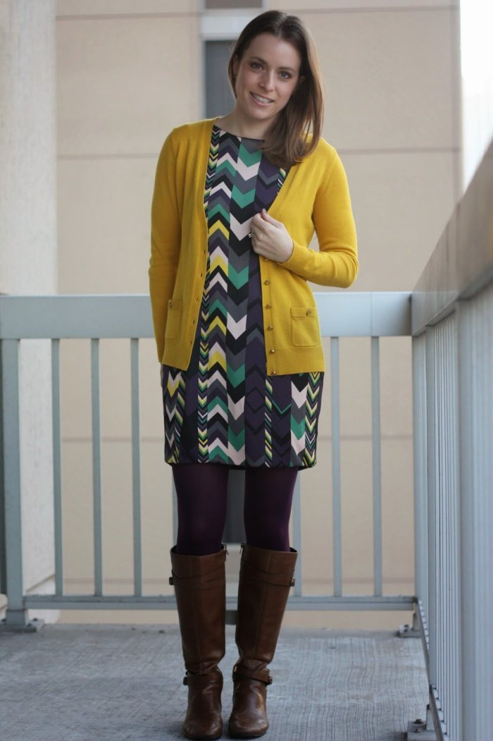 FashionablyEmployed.com | Multi-colored chevron dress with mustard cardigan, purple tights, and cognac boots. Bright colors and patterns in work appropriate styles for the office.