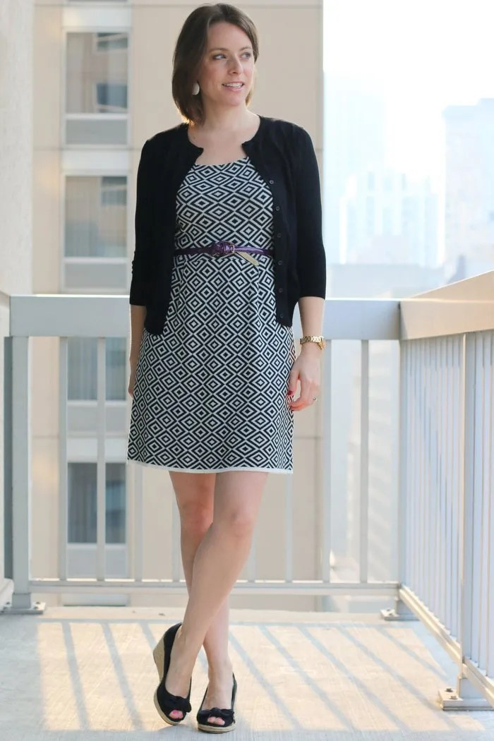 FashionablyEmployed.com | Black and white dress with black cardigan, purple knotted belt, black wedges | working mom style and lifestyle blog, work outfit, business casual, office style