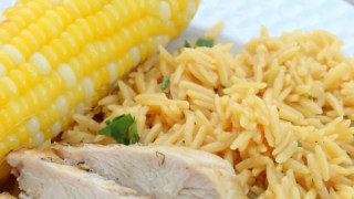 FashionablyEmployed.com | Easy weeknight dinner perfect for the grill: Grilled chicken, saffron orzo and corn on the cob. | A simple recipe for busy moms long on ambition and short on time!