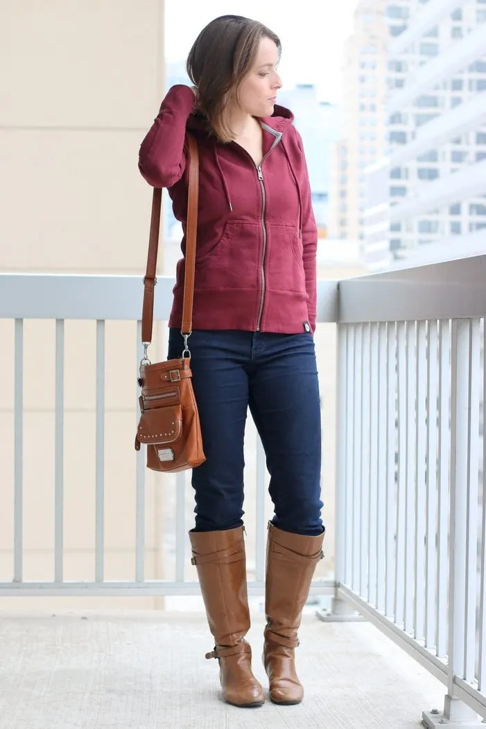 FashionablyEmployed.com | Casual style for an easy going work from home casual Friday, American Giant Greatest Hoodie Ever Made with thrifted jeans and cognac boots and crossbody bag | Simple and sustainable style for everyday professional women | work wear, office style