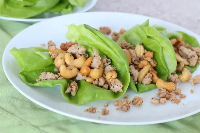 Cashew Chicken Lettuce Wraps: Need a quick, easy and healthy lunch or dinner idea? This can be prepared over the weekend and thrown together in a few minutes to satisfy the whole family.