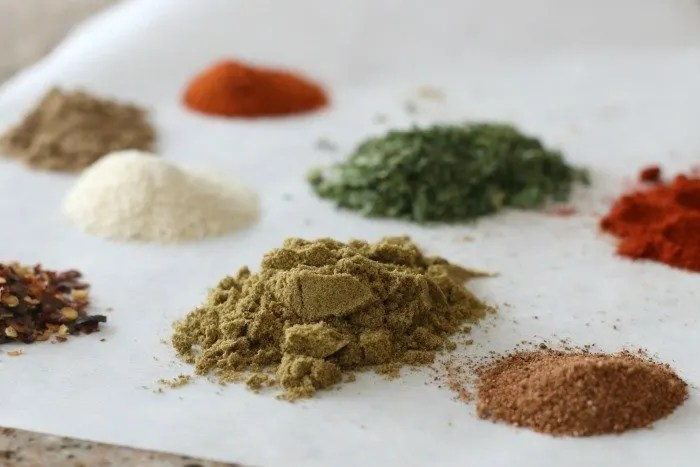 piles of spices on parchment paper