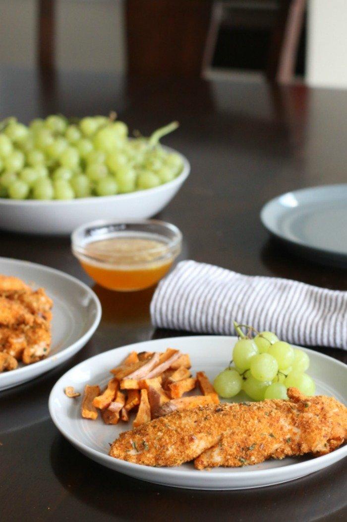 spicy Paleo chicken tenders with sweet citrus sauce vertical