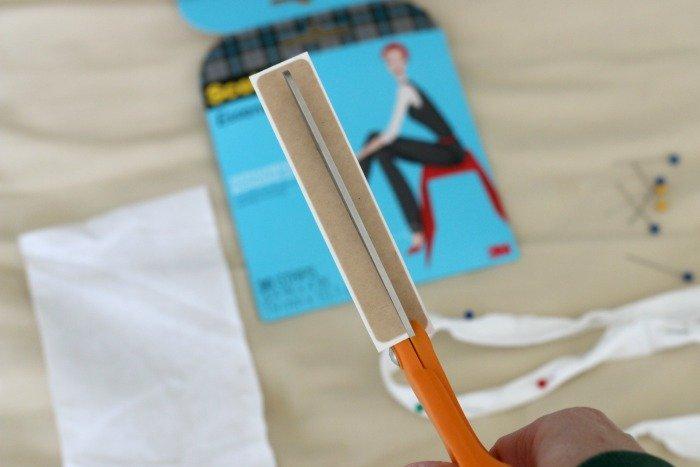 cutting strip of bonding tape in half
