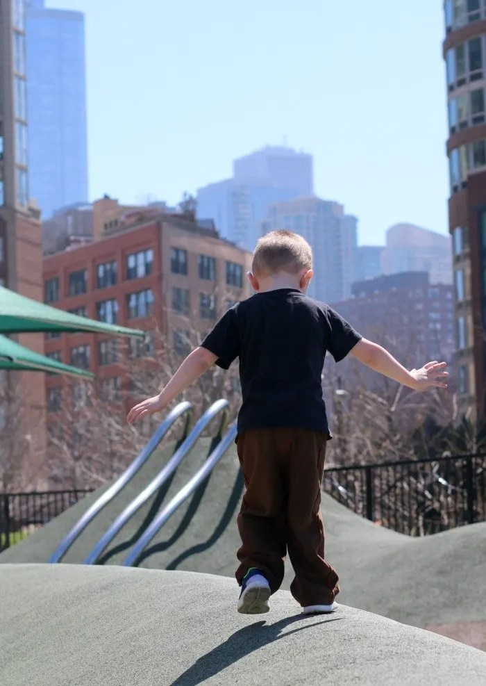 little boy walking on playground