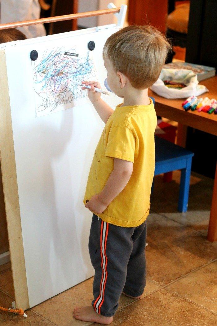 little-boy-coloring-on-a-handmade-easel