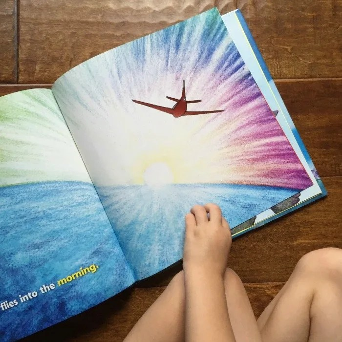 looking-at-the-airplane-book-on-the-floor