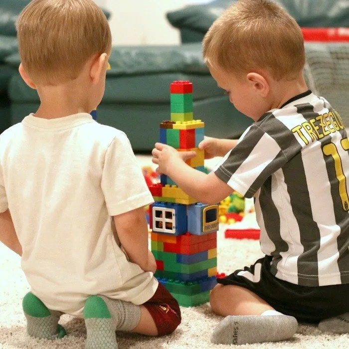 two-little-boys-building-a-rocketship-from-duplo-legos