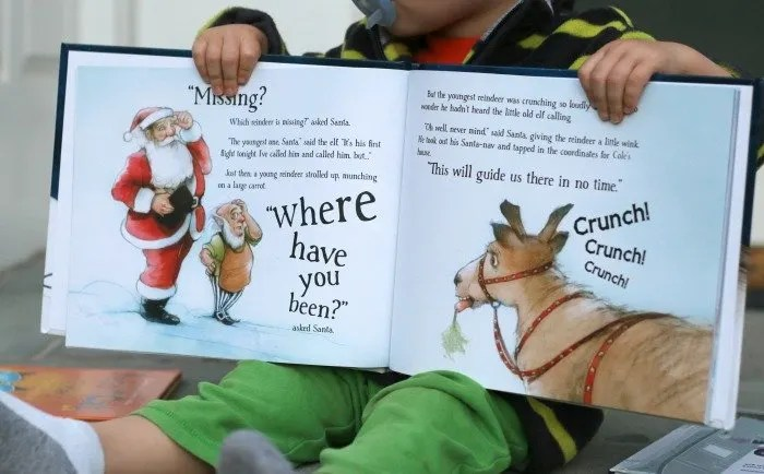 little-boy-holding-a-christmas-personalized-book
