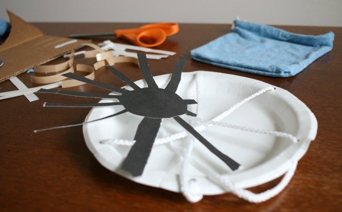 white-paper-plate-as-a-spider-web-with-black-paper-spider