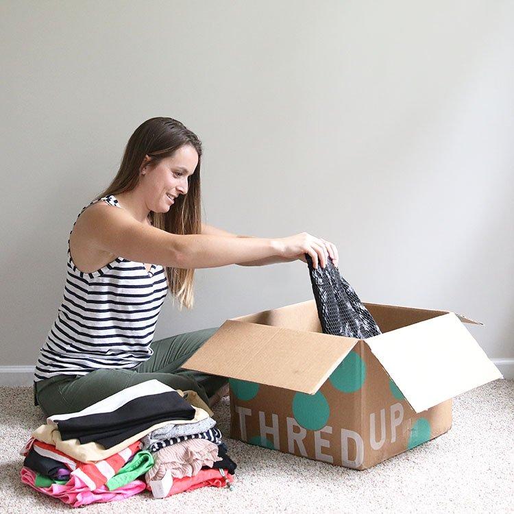 woman going through thredup Rescues box