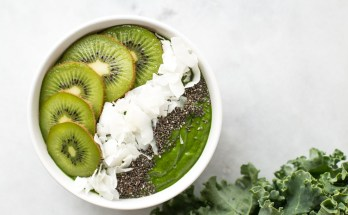 A simple low-sugar green smoothie bowl with healthy ingredients including leafy greens, nut butter, coconut flakes, banana, and chia seeds. {paleo + vegan + sugar free} | www.honestlynourished.com