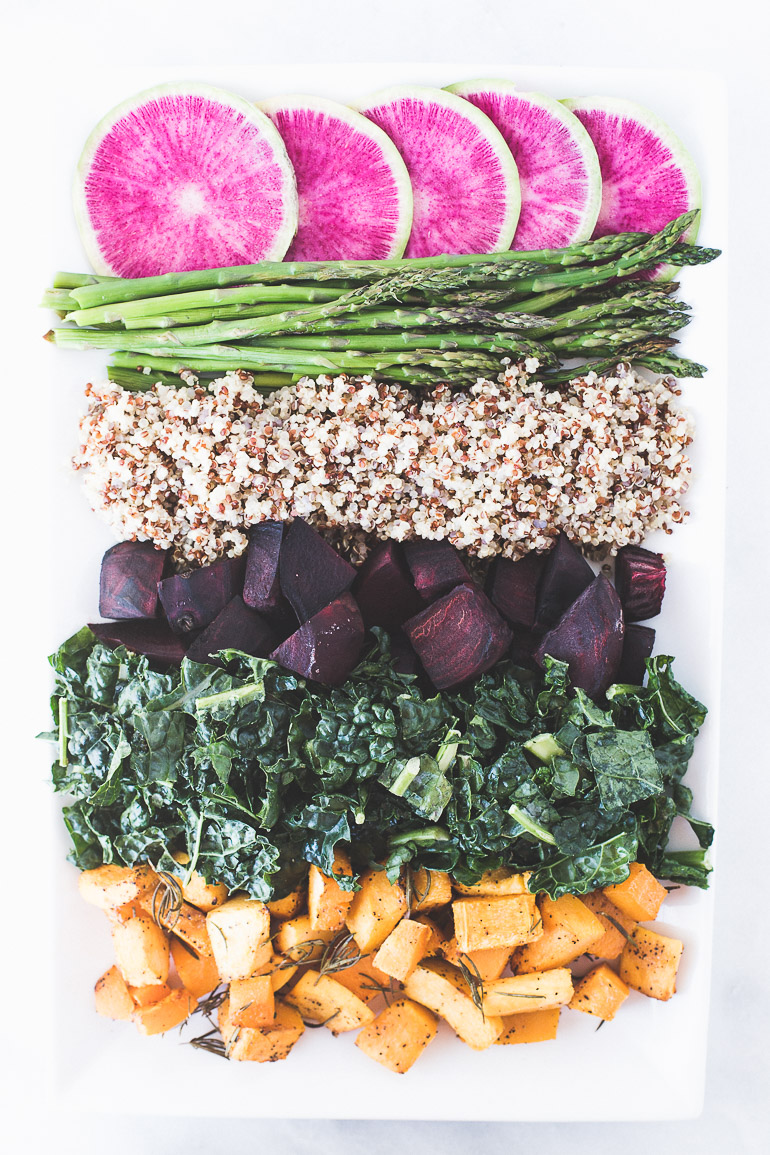 Grounding Massaged Kale Salad with Butternut Squash and Lemon Tahini Dressing | This nourishing salad is full of nutrient-rich vegetables like beets, kale, watermelon radishes, and butternut squash, and gets plenty of protein from quinoa. It's vegan, vegetarian, and simple to prepare. Click to get the recipe! | Honestly Nourished | www.honestlynourished.com