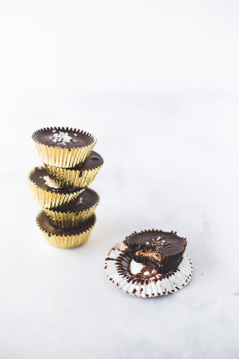 Salted Dark Chocolate Almond Butter Cups | VEGAN + PALEO + GLUTEN FREE + REFINED SUGAR FREE | The perfect way to quench a craving for Reese's peanut butter cups without all the processed junk! These almond butter cups are decadent yet secretly healthy thanks to nourishing, nutrient-rich raw cacao powder, anti-microbial superstar coconut oil, and lightly sweetened with maple syrup. Click to get the recipe! | Honestly Nourished | www.honestlynourished.com