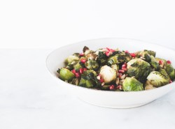 Roasted Dijon Brussels Sprouts with Pomegranate Sprinkles & Toasted Sunflower Seeds | A superfood side dish packed with cancer-fighting antioxidants that's full of seasonal fall flavors. The sweet pomegranate seeds brighten and balance the tart mustard dressing and the sunflower seeds at a nutty crunch. Healthy, gluten free, refined sugar free, and easy to make. Click to get the recipe! | Honestly Nourished | www.honestlynourished.com