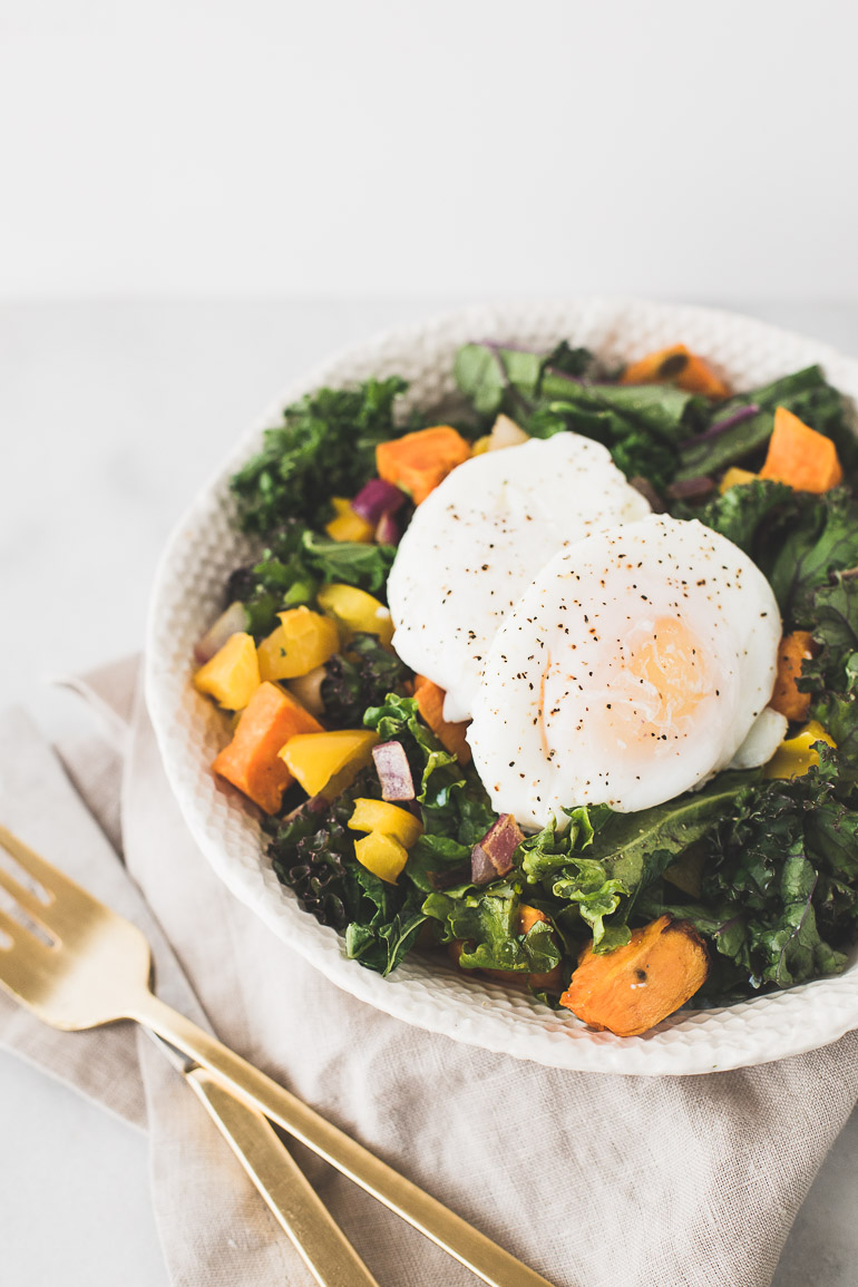 EASY BREAKFAST SALAD WITH POACHED EGGS & WILTED KALE | Vegetarian + Paleo + Gluten Free + Dairy Free | Skip the sugary cereal and donuts and instead make this delicious and simple recipe. A nourishing breakfast salad with warm greens, sweet potato, bell pepper and drippy poached eggs will help you start you day healthy! | Click to get the recipe! | Honestly Nourished | www.honestlynourished.com