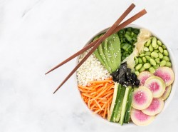 This deconstructed sushi bowl with cauliflower rice and ginger miso dressing is the easiest way to recreate your favorite sushi roll at home! | gluten free + vegetarian + paleo + vegan option | via Honestly Nourished