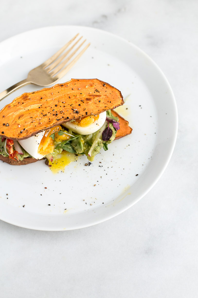 A nutritious twist on a breakfast classic, you'll love this simple recipe for crispy sweet potato avocado toast with soft-boiled eggs and greens! | {gluten free + grain free + paleo + vegetarian} | via Honestly Nourished