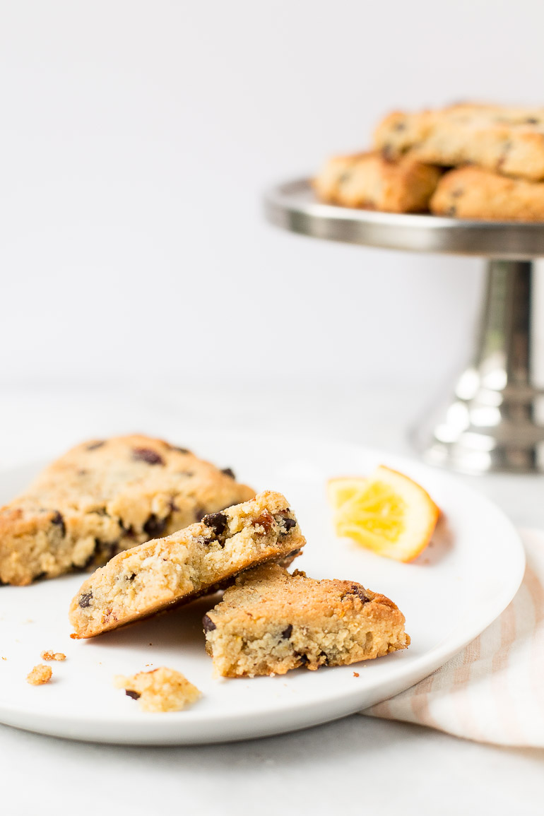 Make your mama proud by baking her (or any moms in your life) a batch of these grain-free, vegan cranberry orange scones with chocolate chips. They're paleo, perfectly tender without sugar, gluten, or dairy and naturally sweetened with orange juice and honey only!