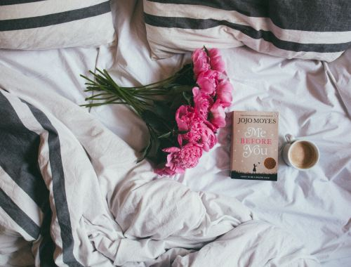 introvert bed with flowers and book