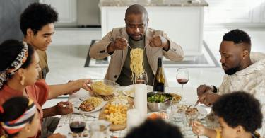 Family eating at home dinner table