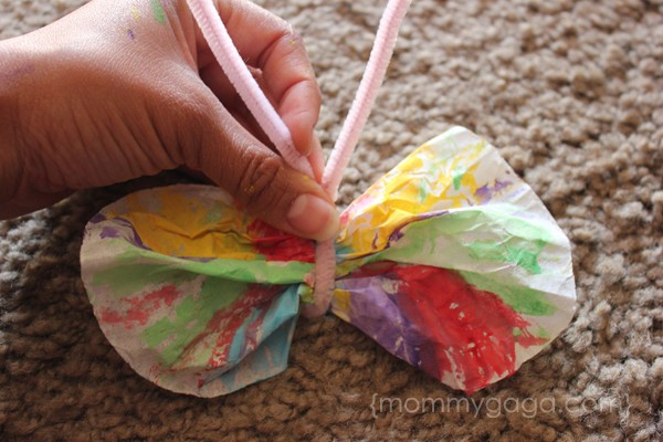 Tie pipe cleaners to make coffee filter butterfly