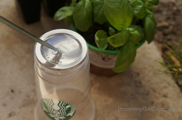 How to make Starbucks Cup Planters - cut hole on the bottom
