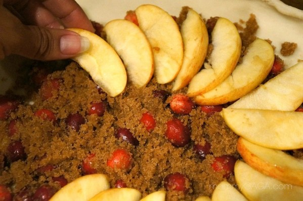 Lay sliced apples on the Apple Cranberry tart