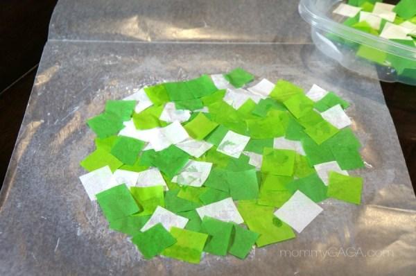 Making a paper shamrock suncatcher - Arrange tissue paper squares glued to wax paper