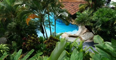 Aerial view of the swimming pool with watersilde, Si Como No Resort in Costa Rica