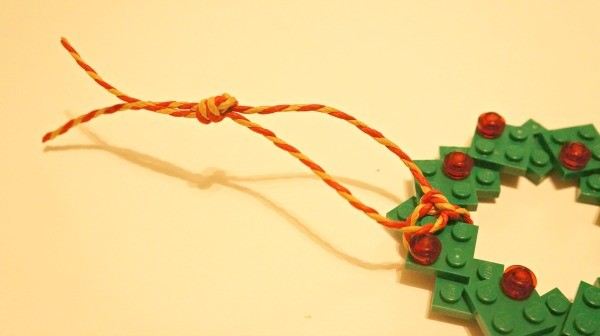 How to make a LEGO wreath photo ornament, knot the end of the ribbon