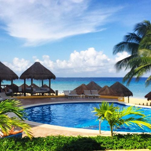 The adult pool overlooking the ocean at Melia Cozumel Golf and Beach Resort, Mexico