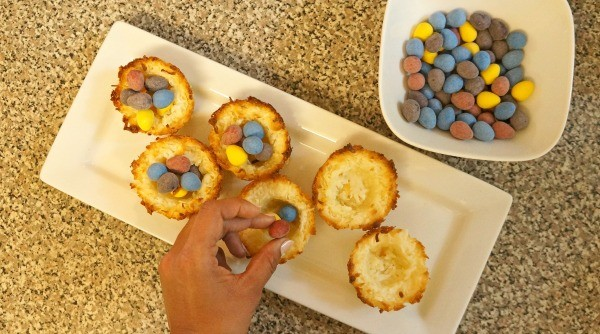 Place Easter eggs into coconut bird nests