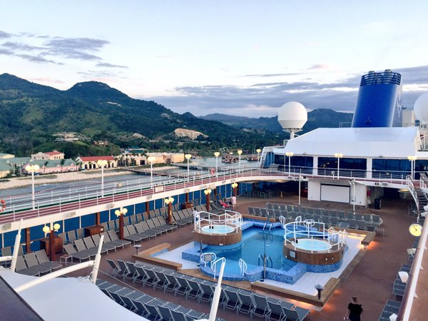 Fathom Travel, view of the Adonia pool and jacuzzi, deck 9, docked in the Dominican Republic