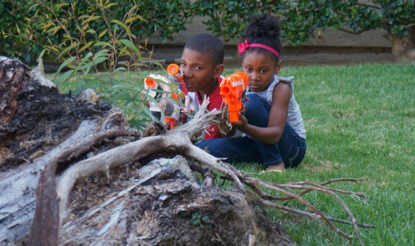 Kids getting ready for their backyard battle with NERF N-Strike dart blasters!