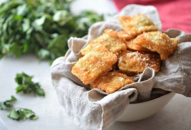 Oven toasted ravioli with a Parmesan crust - great appetizer recipe for parties and events