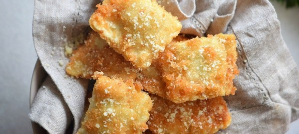 We love this oven toasted ravioli recipe made with a Parmesan crust