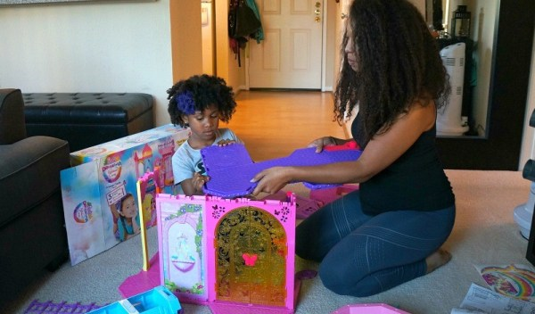 Mom and daughter build the Barbie Rainbow Cove Princess Castle Playset