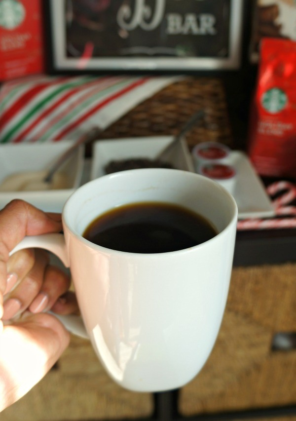 Hot cup of Starbucks Holiday blend coffee
