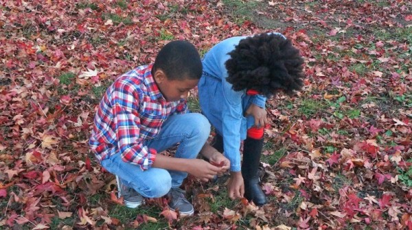 Kids in durable Oshkosh B'gosh holiday clothes playing in the leaves