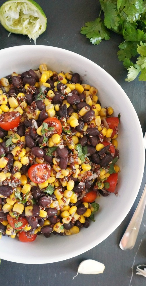 This healthy southwest black bean and corn salad recipe with red quinoa is packed with protein and fresh vegetables, an easy recipe to try!