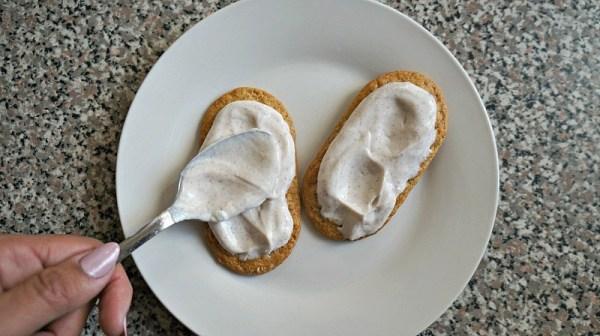 Spreading cinnamon Greek yogurt on a healthy banana breakfast bar recipe