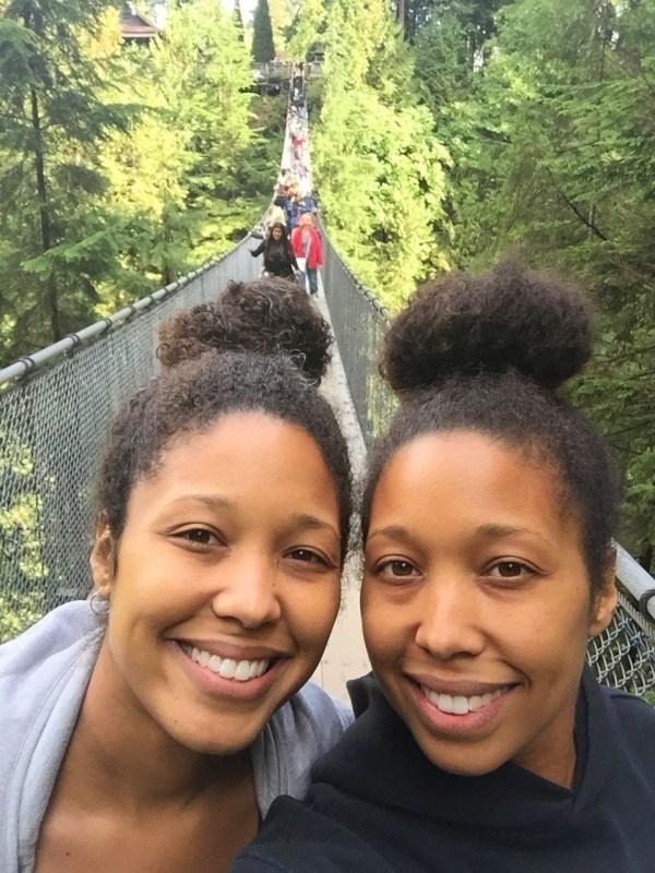 Girls cross the Capilano Suspension Bridge in Vancouver BC Canada