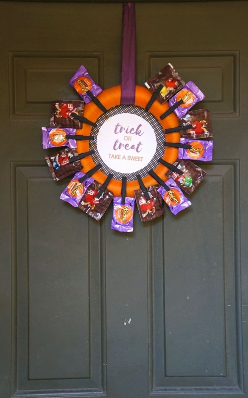 DIY Halloween Candy Wreath Craft perfect for trick or treaters when youre not home