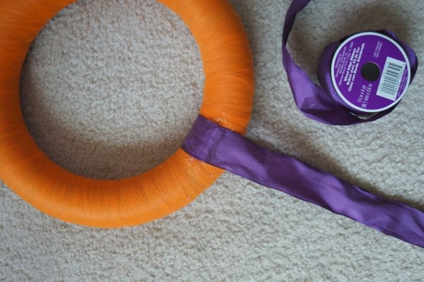 Making a halloween candy wreath glue on ribbon