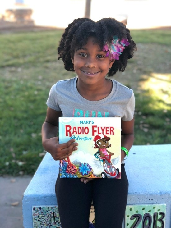 Inspire your child's love for reading - beautiful little girl loves her Radio Flyer Personalized Adventure Book