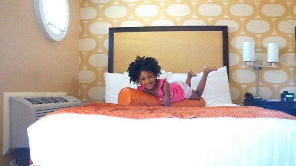 Kid on bed at Seacrest Oceanfront Hotel in Pismo Beach