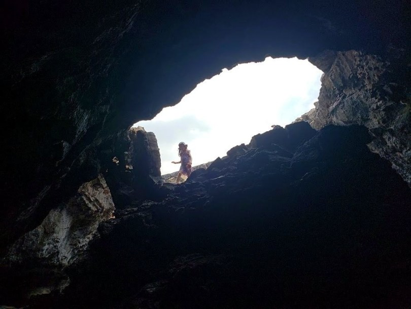 Looking up and out of a lava cave in the Big Island Hawaii